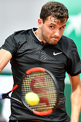 PARIS, June 2, 2017  Grigor Dimitrov of Bulgaria returns the ball to Pablo Carreno Busta of Spain during the men's singles 3rd round match at the French Open Tennis Tournament 2017 in Paris, France on June 2, 2017. (Credit Image: © Chen Yichen/Xinhua via ZUMA Wire)