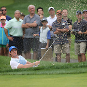 Rory McIlroy chips out of the sand trap on the second hole during the third round of theThe Barclays Golf Tournament at The Ridgewood Country Club, Paramus, New Jersey, USA. 23rd August 2014. Photo Tim Clayton
