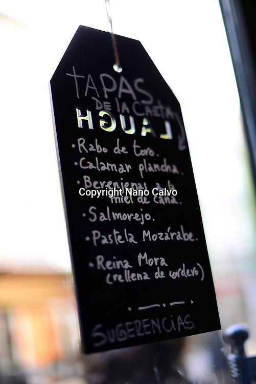 Tapas menu at La Bicicleta restaurant, Granada, Spain