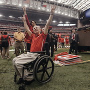Texas governor Greg Abbott and University of Houston president, Renu Khator, wave to the crowd during the game.<br /> <br /> Todd Spoth for The New York Times.