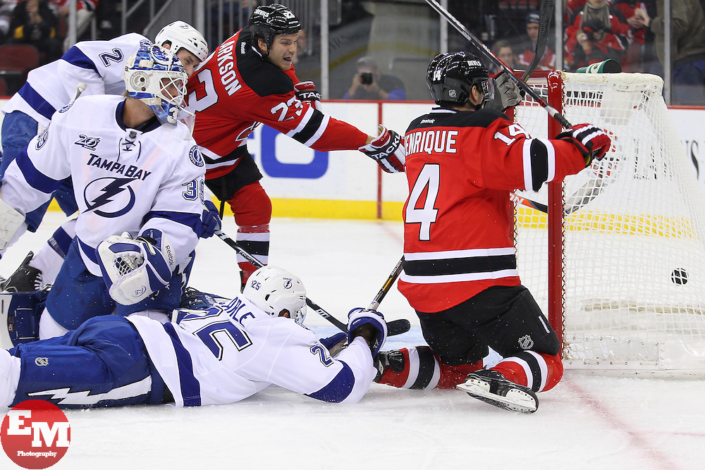 Feb 7, 2013; Newark, NJ, USA; New Jersey Devils center Adam Henrique (14) scores a goal past Tampa Bay Lightning goalie Anders Lindback (39) during the second period at the Prudential Center.