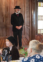 Bill Bickford wearing a traditional wool coat and carriage top hat from the 1800's during the fashion show at Thompson Ames Historical Society's tea and luncheon on Saturday afternoon.  (Karen Bobotas/for the Laconia Daily Sun)