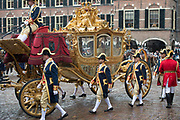 "Prinsjesdag - Koninklijke familie in de Gouden Koets<br /> <br /> Budget Day - Royal family in the Golden Coach<br /> <br /> Op de foto / On the photo:  Gouden Koets / Golden Coach  Gouden Koets met de "" slavenillustratie "" // <br /> Golden Coach with the ""slaves illustration"""