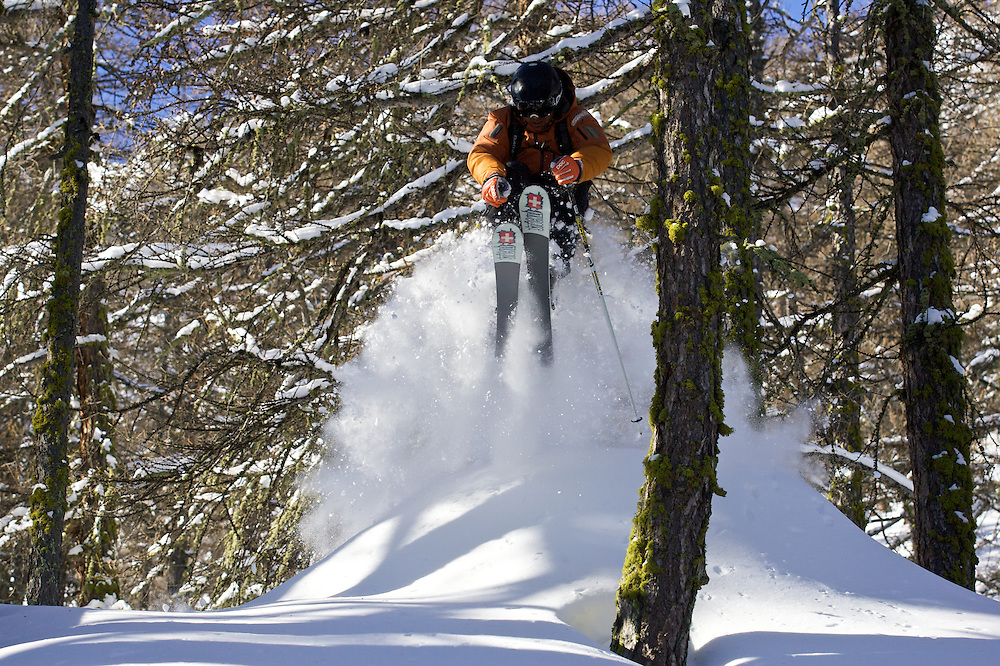 Male Skier Skiing through the forest. Serre Chevalier, France