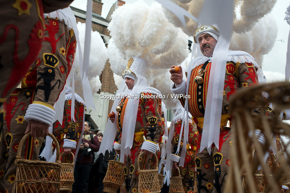 Belgium, carnaval of Binche. UNESCO World Heritage Parade Festival. Belgium, Walloon Municipality, province of Hainaut, village of Binche. The carnival of Binche is an event that takes place each year in the Belgian town of Binche during the Sunday, Monday, and Tuesday preceding Ash Wednesday. The carnival is the best known of several that take place in Belgium at the same time and has been proclaimed as a Masterpiece of the Oral and Intangible Heritage of Humanity listed by UNESCO. Its history dates back to approximately the 14th century.<br /> Events related to the carnival begin up to seven weeks prior to the primary celebrations. Street performances and public displays traditionally occur on the Sundays approaching Ash Wednesday, consisting of prescribed musical acts, dancing, and marching. Large numbers of Binche's inhabitants spend the Sunday directly prior to Ash Wednesday in costume.<br /> The centrepiece of the carnival's proceedings are clown-like performers known as Gilles. Appearing, for the most part, on Shrove Tuesday, the Gilles are characterised by their vibrant dress, wax masks and wooden footwear. They number up to 1,000 at any given time, range in age from 3 to 60 years old, and are customarily male. The honour of being a Gille at the carnival is something that is aspired to by local men