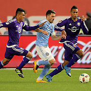 David Villa, NYCFC, is sandwiched by Darwin Ceren, (left) and Tommy Redding, Orlando, during the New York City FC Vs Orlando City, MSL regular season football match at Yankee Stadium, The Bronx, New York,  USA. 18th March 2016. Photo Tim Clayton