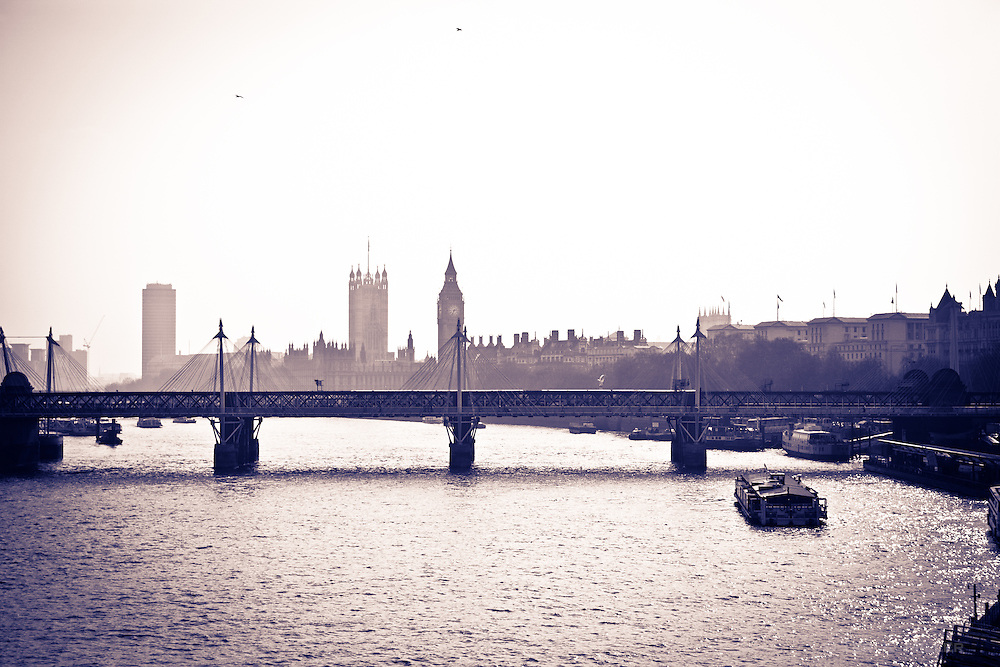 Hungerford Bridge, Big Ben and Parliament from the River Thames, London, England