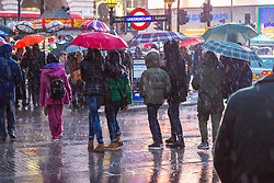 London, December 31 2017. The umbrellas come out as a downpour begins in London's west end ahead of the New Year's Eve fireworks at midnight. PICTURED: People cross Piccadilly as the rain hammers down . © SWNS
