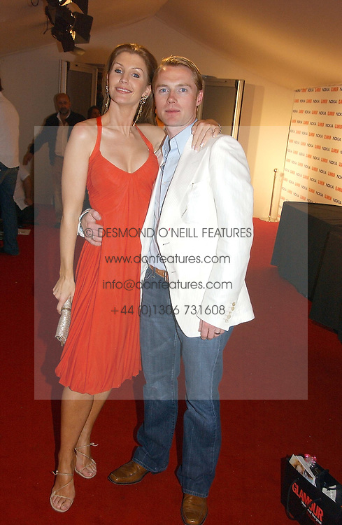 RONAN KEATING and his wife YVONNE at the 2006 Glamour Women of the Year Awards 2006 held in Berkeley Square Gardens, London W1 on 6th June 2006.<br /><br />NON EXCLUSIVE - WORLD RIGHTS