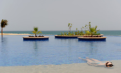 Image ©Licensed to i-Images Picture Agency. 15/06/2009. A lady relaxes in the pool at Desert Island resort on Sir Bani Yas Island, in the United Arab Emirates, a former private nature reserve belonging to the late Sheikh Zayed, The founder of the United Arab Emirates , the Island  has been recently opened to the public.Picture by Andrew Parsons / i-Images