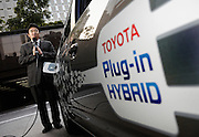 Yutaka Matsumoto, project general manager of Toyota Motor Corp.'s Strategy Planning Dept.'s R&D management center, blows on the recharger hose used for the automaker's plug-in hybrid vehicles at the company's headquarters in Tokyo, Japan on Tuesday 11 March 2009.