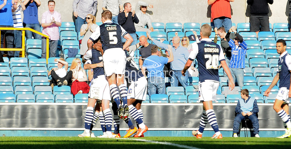 Millwall celebrate retaking the lead during the Sky Bet League 1 match between Millwall and Rochdale at The Den, London, England on 26 September 2015. Photo by Michael Hulf.