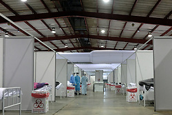 JOHANNESBURG, SOUTH AFRICA - JULY 03: Medical officials attend to Covid patients at the Nasrec quarantine and isolation site on July 03, 2020 in Johanneburg, South Africa. Gauteng MEC Dr Bandile Masuku visited the NASREC Quarantine Site to inspect facilities and monitor patient care experience. The site became operational on June 15. (Photo by Gallo Images/Dino Lloyd)
