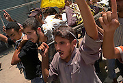 An Islamic Jihad gunmen is given a martyrs funeral after he killed in an Israeli airstrike in Rafah, Gaza August 05, 2007. Taking a moderate political position, Hamas is apparently trying to reign in militant Palestinian factions recently such as Islamic Jihad, pressuring them to abandon their public display of weapons and cease rocket and mortar attacks against Israel, presumably to increase potential bargaining power for eventual negotiations with Fatah and/or Israel and to consolidate it's hold of the strip.  ..