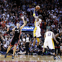 10 March 2011: Los Angeles Lakers shooting guard Kobe Bryant (24) takes a jumpshot over Miami Heat center Zydrunas Ilgauskas (11) during the Miami Heat 94-88 victory over the Los Angeles Lakers at the AmericanAirlines Arena, Miami, Florida, USA.