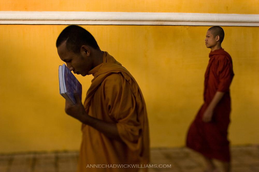 Monks head to a Buddhist temple in Phnom Penh, Cambodia.