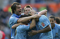 Photo: Lee Earle.<br /> Coventry City v Barnsley. Coca Cola Championship. 17/03/2007.Coventry's Dele Adebola (R) is congratulated by his team mates after scoring their third goal.