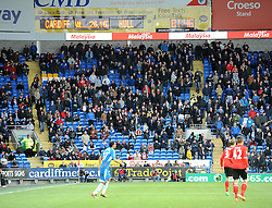 Very few Cardiff City fans remain as the game comes to an end - Photo mandatory by-line: Joe Meredith/JMP - Tel: Mobile: 07966 386802 22/02/2014 - SPORT - FOOTBALL - Cardiff - Cardiff City Stadium - Cardiff City v Hull City - Barclays Premier League