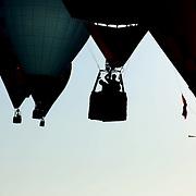 A Hot Air balloonist drops a marker at a goal location around rural Michigan near Battle Creek during the World Hot Air Ballooning Championships. Battle Creek, Michigan, USA. 21st August 2012. Photo Tim Clayton