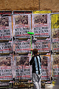 Putting up posters in Bellavista, Santiago, Chile