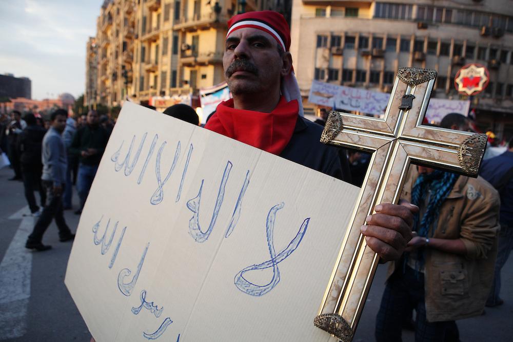 A Coptic Christian demonstrating against Mubarak at Tahrir Square.