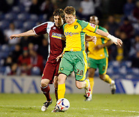 Photo: Paul Greenwood.<br />Burnley v Norwich City. Coca Cola Championship. 17/04/2007.<br />Burnley's Wade Elliott (L) battles with Michael Spillane