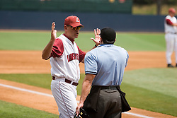 Lafayette Leopards Head Coach Joe Kinney (25) argues a call with the home plate umpire.  The Lafayette Leopards fell to the the Rutgers Scarlet Knights 11-10 in their second game of the NCAA World Series Regional held at Davenport Field in Charlottesville, VA on June 2, 2007.