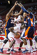 FAYETTEVILLE, AR - DECEMBER 19:  Fred Gulley III #12 of the Arkansas Razorbacks is defended under the basket by Myles Taylor #33 of the UT Martin Skyhawks at Bud Walton Arena on December 19, 2013 in Fayetteville, Arkansas.  The Razorbacks defeated the Skyhawks 102-56.  (Photo by Wesley Hitt/Getty Images) *** Local Caption *** Fred Gulley III; Myles Taylor