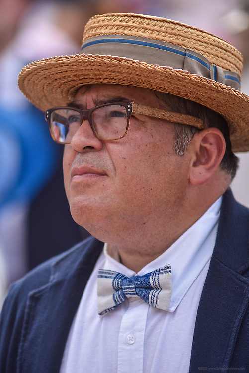 Oscar Delossantos watches the 8th race wearing a bow tie he purchased at locally at Hey Tiger at the 142nd running of the Kentucky Derby. May 7, 2016