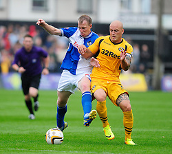 Bristol Rovers' David Clarkson jostles for the ball with Newport County's David Pipe - Photo mandatory by-line: Dougie Allward/JMP - Tel: Mobile: 07966 386802 17/08/2013 - SPORT - FOOTBALL - Rodney Parade - London - Newport County V Bristol Rovers - Sky Bet league two