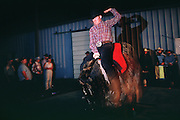 05 AUGUST 2000 - WILLIAMS, AZ: A man rides the mechanical bull at the 22nd Annual Cowpunchers' Reunion Rodeo in Williams, Arizona, Aug 5.  The Cowpunchers' Reunion Rodeo is held for working cowboys from the ranches in Arizona and the region. PHOTO BY JACK KURTZ
