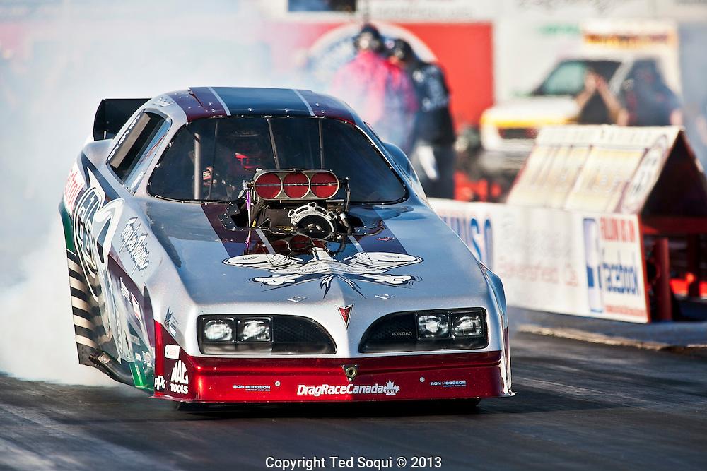 Funny Car Top Eliminator Tim Boychuck..The 2013 March Meet at the Auto Club Famoso Raceway in McFarland, CA.