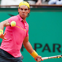 31 May 2009: Rafael Nadal of Spain eyes the ball as he hits a forehand during the men's Singles fourth round match on day eight of the French Open at Roland Garros in Paris, France.