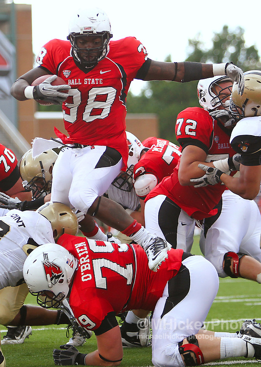 Sept. 24, 2011; Muncie, IN, USA; Ball State Cardinals running back Jahwan Edwards (38) goes over the top for a touchdown against the Army Black Knights at Scheumann Stadium. Ball State defeated Army 48-21. Mandatory credit: Michael Hickey-US PRESSWIRE