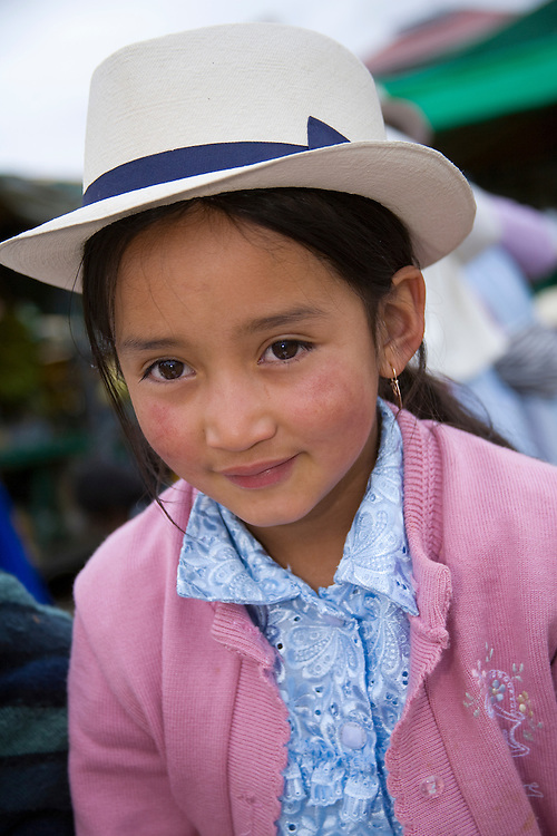 Girl at weekly produce market, Gualaceo (near Cuenca), Ecuador, South America
