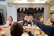 In the Bakers' kitchen, Pickwell Manor, Georgeham, North Devon, UK. From left to right: Liza Baker (9), Millie-grace Elliott (8), Molly Elliott (10), Tracey Elliott.<br /> CREDIT: Vanessa Berberian for The Wall Street Journal<br /> HOUSESHARE
