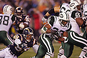 SAN DIEGO, CA - JANUARY 8:  Running back Curtis Martin #28 of the New York Jets was held to 66 yards rushing on 18 carries by linebacker Donnie Edwards #59 and the San Diego Chargers at Qualcomm Stadium on January 8, 2005 in San Diego, California. The Jets defeated the Chargers 20-17 in overtime in the AFC Wild Card Game. ©Paul Anthony Spinelli  *** Local Caption *** Curtis Martin; Donnie Edwards