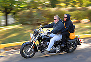 BENSALEM, PA - OCTOBER 5: An unidentified man and woman ride on a motorcycle during the  Libertae 10th Annual Biker's and Babes Ride October 5, 2014 in Bensalem, Pennsylvania.  Libertae, a women's substance abuse treatment center, hosted the event, which runs through Bucks County before ending at Core Creek Park. (Photo by William Thomas Cain/Cain Images)