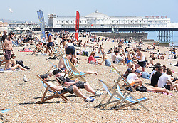 © Licensed to London News Pictures. 21/05/2020. Brighton, UK. Members of the public relax in the hot weather on Brighton seafront in East Sussex, during lockdown to prevent to spread of COVID-19.  Photo credit: Liz Pearce/LNP