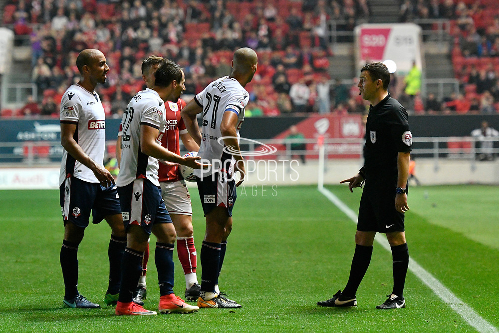Filipe Morais (22) of Bolton Wanderers goes to complain to referee Tony Harrington after being shown a red card, sent off during the EFL Sky Bet Championship match between Bristol City and Bolton Wanderers at Ashton Gate, Bristol, England on 26 September 2017. Photo by Graham Hunt.