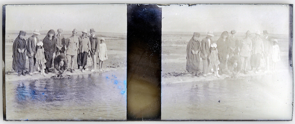 stereo image of family group standing by water edge