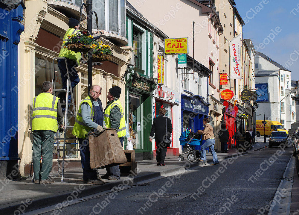 Ennis town council workers putting out the first signs of summer.<br />