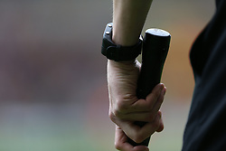 The linesman's watch and flag during Wolverhampton Wanderers' and Birmingham's match at the Molineux ground