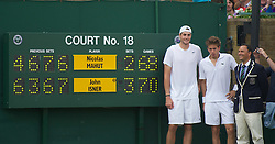 24.06.2010, Wimbledon, GBR, ATP World Tour, Grand Slam, Wimbledon, Men's singles, John Isner (USA) vs Nicolas Mahut (FRA), im Bild John Isner (USA) poses with Nicolas Mahut and Umpire Mohamed Lahyani next to the scoreboard after the historic longert game ever that lasted 11 hours and five minutes over three days. He beat Nicolas Mahut with the final score of 6-4 3-6 6-7 (7-9) 7-6 (7-3) 70-68 on day four. EXPA Pictures © 2010, PhotoCredit: EXPA/ Propaganda/ D. Rawcliffe / SPORTIDA PHOTO AGENCY