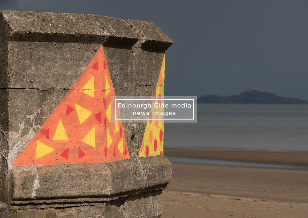 """Across Portobello, Edinburgh, artists revealed their work to the public for the start of this weekend's Art Walk Porty. A mixture of open studios, pop-up exhibition spaces, artists market and site-specitic art all over the Edinburgh suburb this weekend. The event runs from Fri-Sun Sept 2nd-4th. 2016. Pictured: """"Twelve Bakers"""" at the foot of Kings Road by Kate Tweddle and Elaine Maher.<br /> <br /> © Jon Davey/ EEm"""