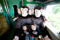 Two young boys in the fluffy animal seats of the special JR Asahiyama Zoo train.