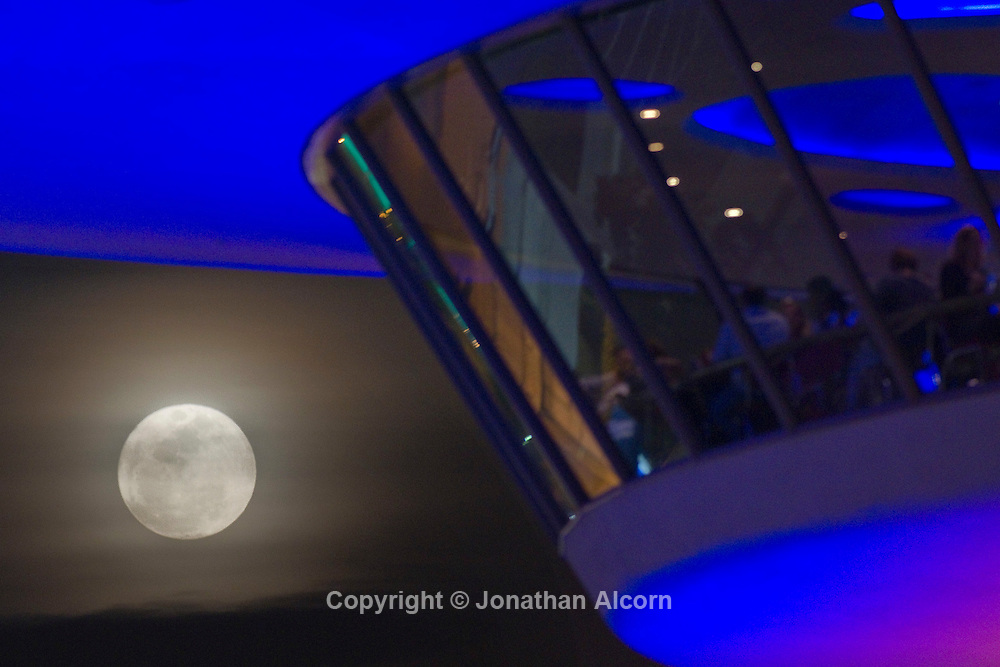 "The full moon tonight , called a ""Super Perigee Moon"" since it is at its closest to Earth in 2011, rises behind The Encounter restaurant & bar at LAX (Los Angeles International Airport) The previous full moon so big and close to Earth occurred in March of 1993."