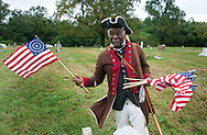 "SHANNAH08P<br /> Joe Becton of Philadelphia, Pennsylvania plants 35 star American flags on graves after a dedication ceremony honoring Hannah Till Saturday October 3, 2015 at Eden Cemetery in Collingdale, Pennsylvania. Hannah Till, a free black woman and unsung hero of the Revolutionary War who worked for Gens. George Washington and Lafayette is being honored as a ""Patriot"" by the Daughters of the American Revolution with a special ceremony and headstone dedication at Eden Cemetery, a historically-black cemetery in Collingdale. (William Thomas Cain/For The Inquirer)"