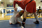 2006.02.02 HILLSBOROWRESTLER SPORTS : Hillsboro sophomore wrestler Dustin Carter gets a little help from teammate Greg Rhoads trying to figure out why he just lost his match to Amelia's Tommy Fehring at Amelia High School Thursday February 2, 2006. The Enquirer/Jeff Swinger