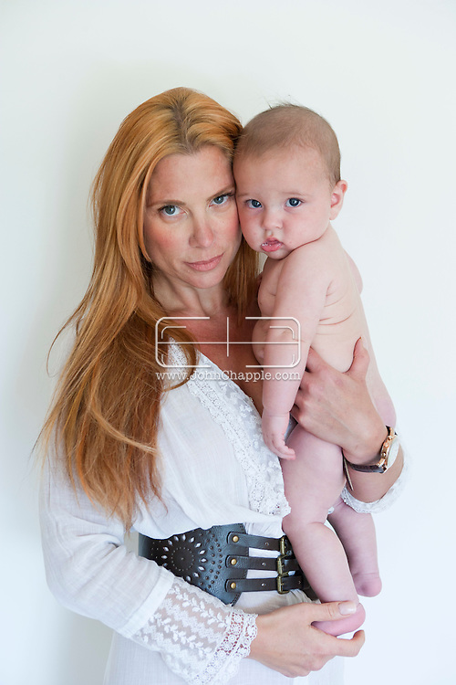 15th August 2011. Los Angeles, California. Socialite Taylor Stein pictured in her Los Angeles home with her 5-month-old son, Ren Stein.  PHOTO © JOHN CHAPPLE / www.chapple.biz